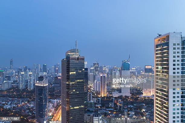 jakarta cityscape - emerging markets stock photos and pictures
