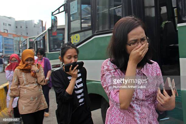 Jakarta commuters try to protect themselves from smoke produce by motor vehicles on May 30 2014 in Jakarta Indonesia Recent reports have ranked...