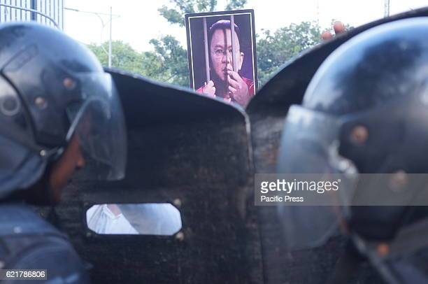 Jakarta Governor Basuki ''Ahok'' Tjahaja Purnama photo in front of polices guard as Islamic Defender Front protest in front of Presidential Palace...