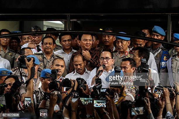 Jakarta Governor Basuki Tjahaja 'Ahok' Purnama talks to journalists shortly after investigation by the police at Police Headquarter on November 7...