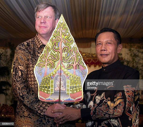 Jakarta Governor Sutiyoso holds a wayang together with the mayor of Rotterdam Ivo Opstelten in Jakarta 14 August 2005 Ivo Opstelten handed over an...