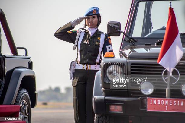 A woman soldier that force inspection during the ceremonial will drive Indonesian president for Indonesia Millitary held anniversary ceremonial at...
