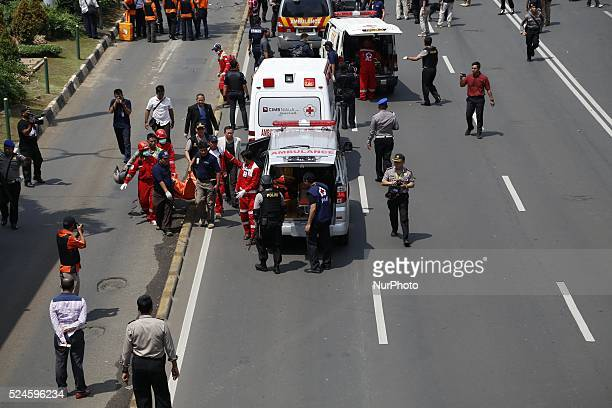 Vicitm of the bomb carried to ambulance Several terrorist attack starbucks cafe at sarinahJakarta causing arround 6 people dead