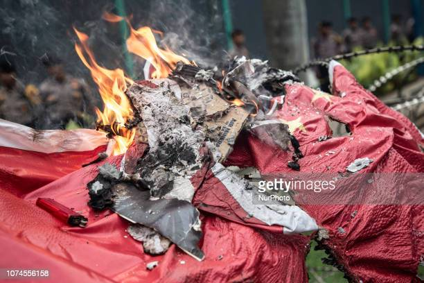 Chine burnt flag during the demonstration Arround thousand of muslims held demonstration in front of China EmbassyJakarta to protest china action to...