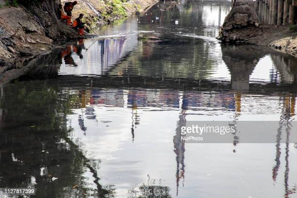 Jakarta, Indonesia, 27 Februari 2019 : Black and Stinky River at North Jakarta-Indonesia as part of canal from Ciliwung River, one of the biggest...