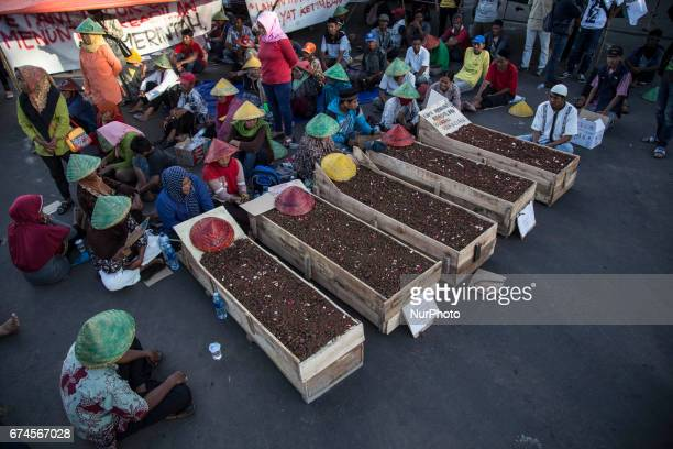 Farmers from Serikat Tani Telukjamber Bersatu held demonstration in front of Merdeka PalaceJakarta by buried them self in the grave made of wood The...