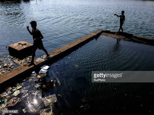 View of Children and condition of sea level at Muara BaruNorth Jakarta that already above the ground Jakarta is one of the fastest sinking cities in...