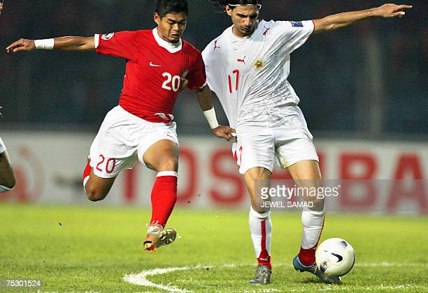 Bahrain's Husein Baba vie for the ball with Indonesian Bambang Pamungkas during the Asian Cup 2007 Group D football match at the Bung Karno stadium...