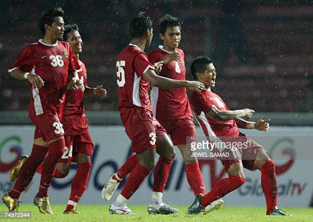Bambang Pamungkas of Indonesia celebrates with teammates after scoring a goal against Hong Kong during their friendly international match in Jakarta...