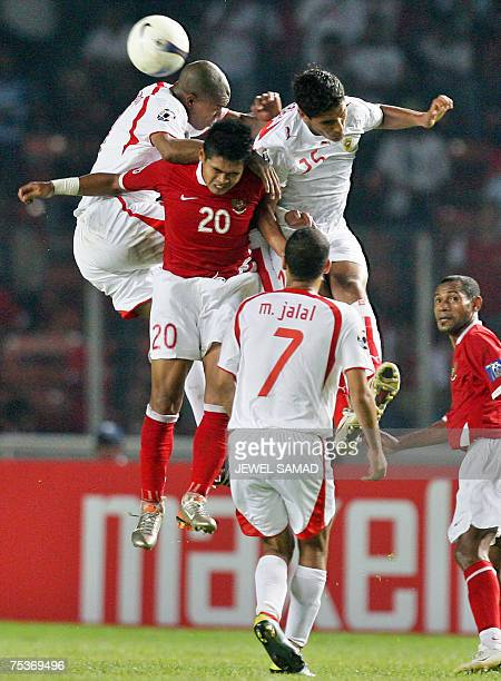 Indonesian Bambang Pamungkas heads the ball with Bahrain's players during the Asian Cup 2007 Group D football match at the Bung Karno stadium in...