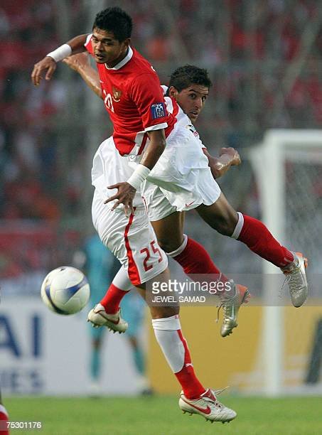 Indonesian Bambang Pamungkas vies for the ball with Bahrain's Fauzi Aish during their Asian Cup 2007 Group D football match at the Bung Karno stadium...