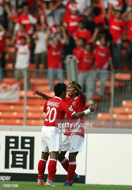 Indonesian Budi Sudarsono celebrates with teammate Bambang Pamungkas after scoring a goal during the Asian Cup 2007 Group D football match against...
