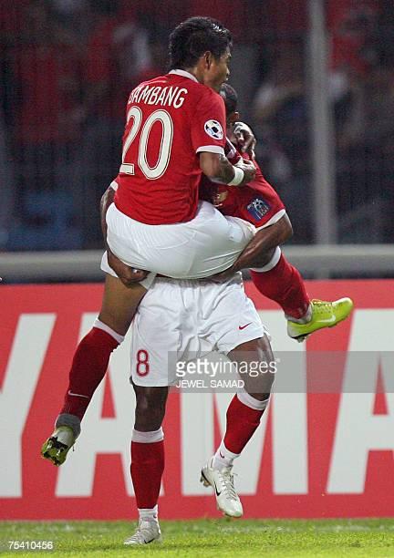Indonesian Ellie Aiboy hugs teammate Bambang Pamungkas after scoring a goal against Saudi Arabia during their Asian Cup 2007 Group D football match...