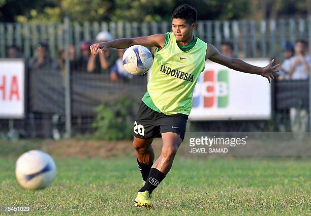 Indonesian national football team player Bambang Pamungkas kicks a ball during a training session in Jakarta 17 July 2007 Indonesia will play against...