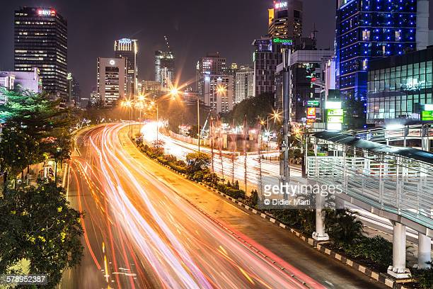jakarta night rush - emerging markets stock photos and pictures