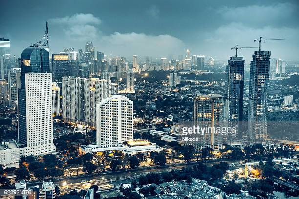 jakarta skyline at dusk - indonesia stock photos and pictures