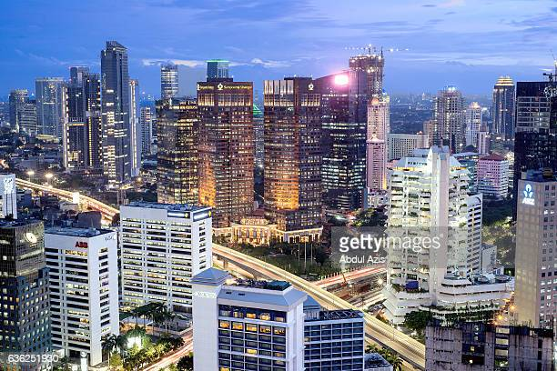 jakarta skyline during bluehour - jakarta stock pictures, royalty-free photos & images
