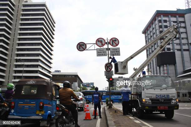 Jakarta Transportation Department officers dismantle traffic signs that prohibit twowheeled vehicles passing on Jalan Mh Thamrin Central Jakarta on...