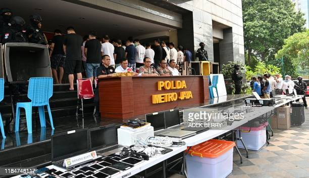 Jakartas chief of police Gatot Eddy speaks during a press conference in Jakarta on November 26 while displaying evidence and Chinese and Indonesian...