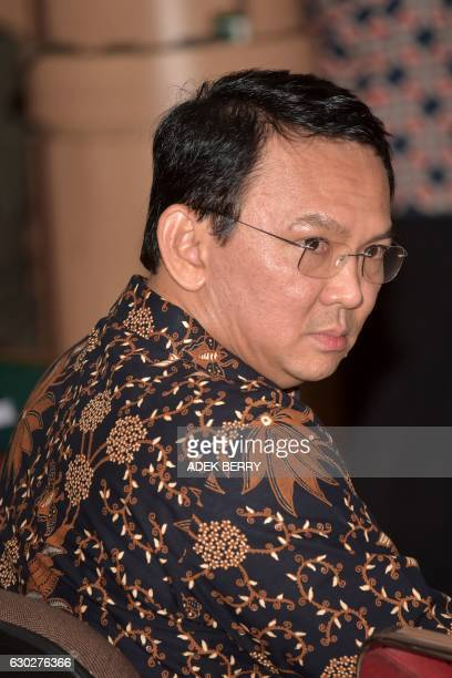Jakarta's Christian governor Basuki Tjahaja Purnama better known by his nickname Ahok sits in a courtroom at the North Jakarta court for his trial...