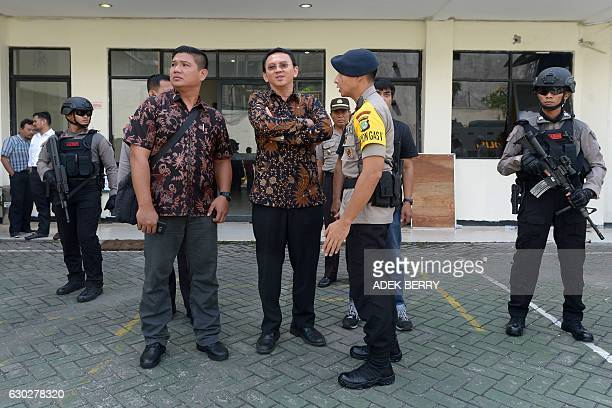 Jakarta's Christian governor Basuki Tjahaja Purnama better known by his nickname Ahok waits inside the complex of the North Jakarta court in Jakarta...