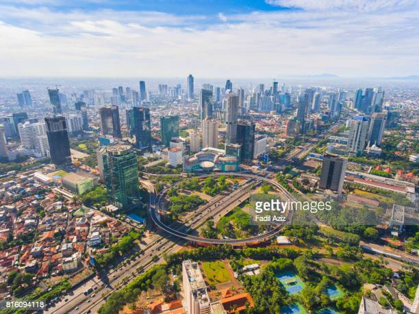 jakarta's new icon, semanggi overpass, in a super bright day - indonesien stock-fotos und bilder