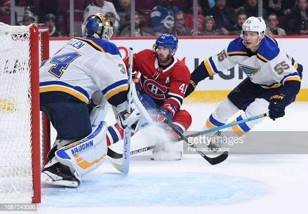 Jake Allen and Colton Parayko of the St Louis Blues defend the goal against Paul Byron of the Montreal Canadiens in the NHL game at the Bell Centre...