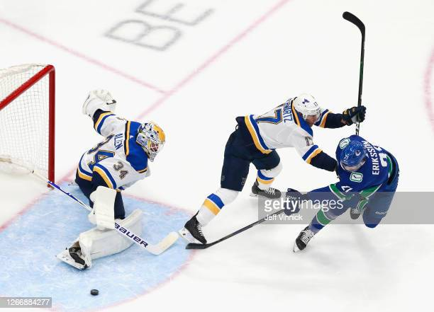 Jake Allen and Jaden Schwartz of the St. Louis Blues defend against Loui Eriksson of the Vancouver Canucks during the first period in Game Four of...