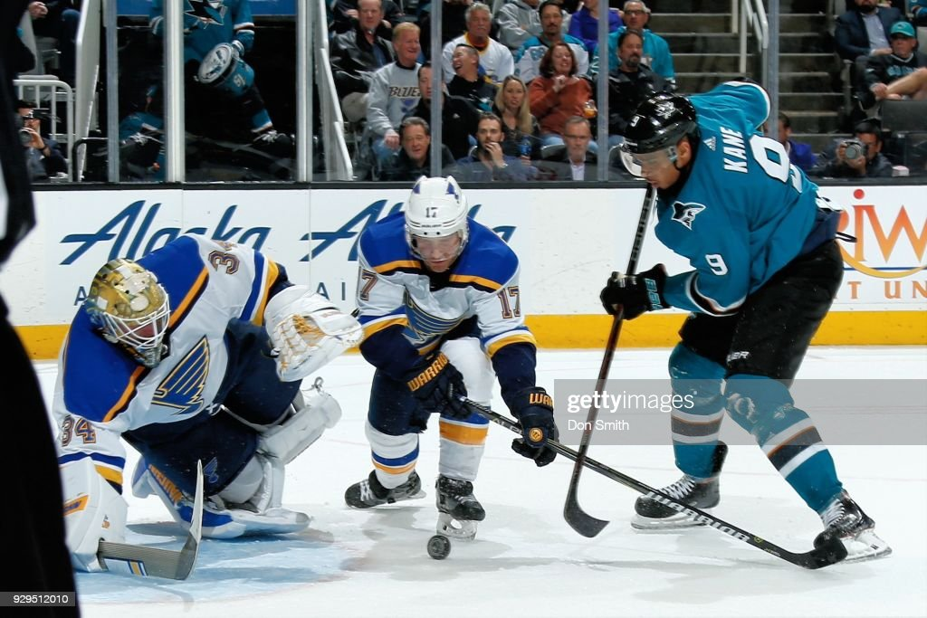 Jake Allen #34 and Jaden Schwartz #17 of the St. Louis Blues defend the net from Evander Kane #9 of the San Jose Sharks at SAP Center on March 8, 2018 in San Jose, California.
