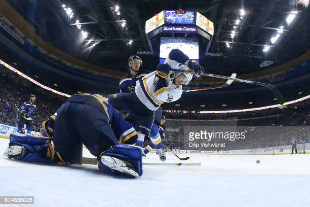 Jake Allen and Jay Bouwmeester of the St. Louis Blues defend against Viktor Arvidsson of the Nashville Predators in Game Two of the Western...