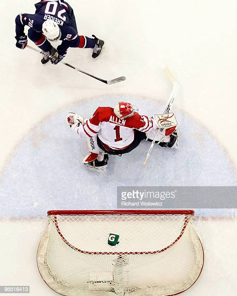 Jake Allen of Team Canada stops the penalty shot attempt by Chris Kreider of Team USA during the 2010 IIHF World Junior Championship Tournament game...