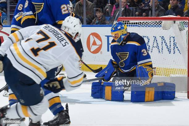Jake Allen of the St Louis Blues blocks a shot made from Evan Rodrigues of the Buffalo Sabres at Scottrade Center on December 10 2017 in St Louis...