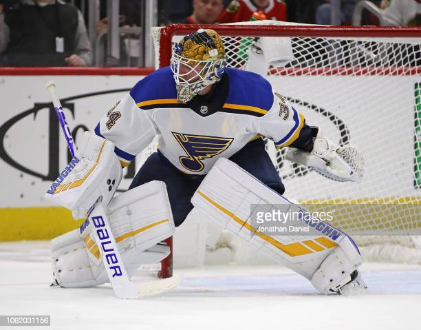 Jake Allen of the St Louis Blues follows the action against the Chicago Blackhawks at the United Center on November 14 2018 in Chicago Illinois The...
