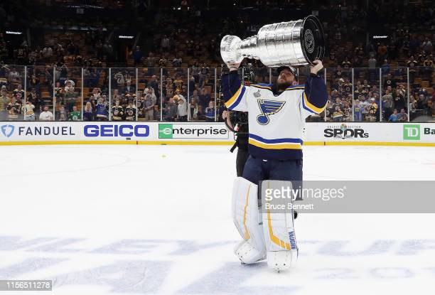 Jake Allen of the St. Louis Blues holds the Stanley Cup following the Blues victory over the Boston Bruins at TD Garden on June 12, 2019 in Boston,...