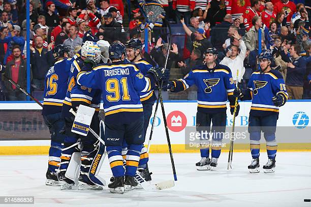 Jake Allen of the St Louis Blues is congratulated by his teammates after beating the Chicago Blackhawks in a shootout at the Scottrade Center on...
