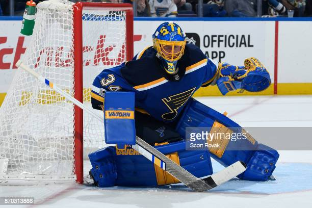 Jake Allen of the St Louis Blues keeps an eye on the puck during the game against the Toronto Maple Leafs at Scottrade Center on November 4 2017 in...