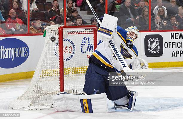 Jake Allen of the St Louis Blues makes a blocker save against the Ottawa Senators in the second period during an NHL game at Canadian Tire Centre on...