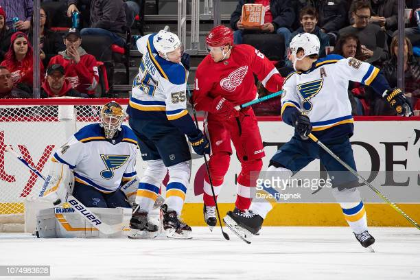 Jake Allen of the St Louis Blues makes a blocker save as teammates Colton Parayko and Alexander Steen of the St Louis Blues battle in front of with...