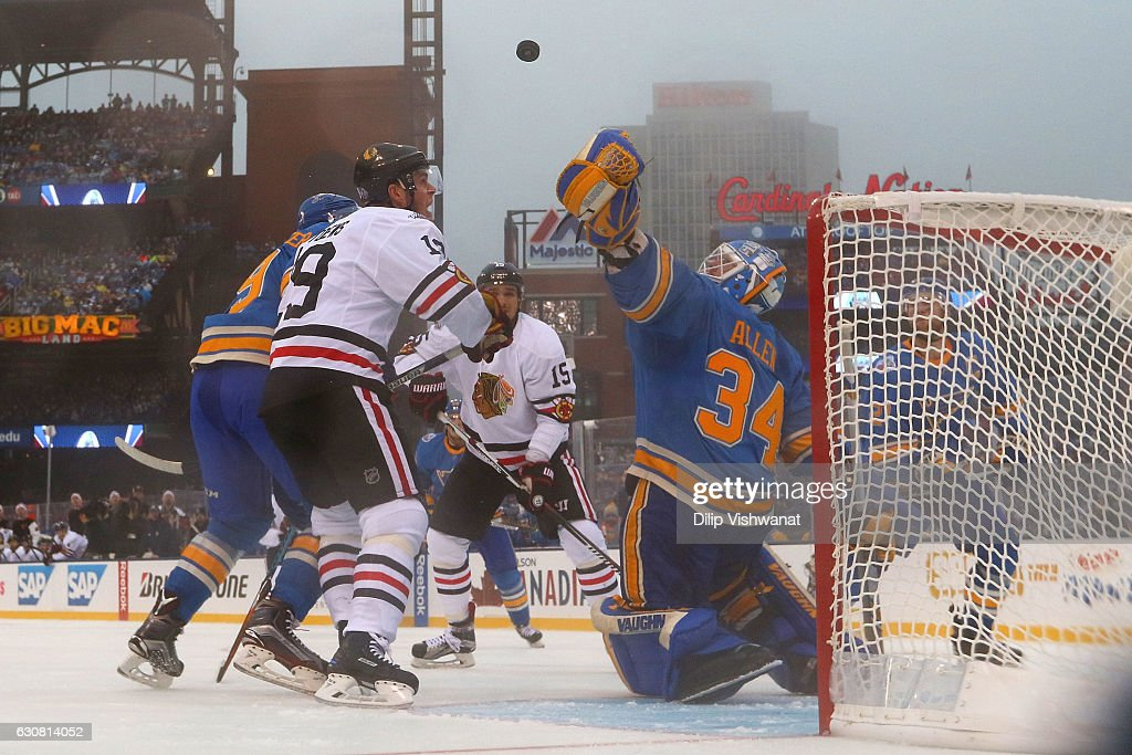 Jake Allen #34 of the St. Louis Blues makes a save against Jonathan Toews #19 of the Chicago Blackhawks during the 2017 Bridgestone NHL Winter Classic at Busch Stadium on January 2, 2017 in St. Louis, Missouri.