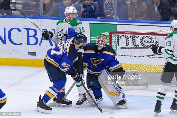 Jake Allen of the St Louis Blues makes a save as Alex Pietrangelo of the St Louis Blues defends against Blake Comeau of the Dallas Stars at...