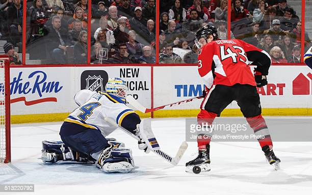 Jake Allen of the St. Louis Blues makes a stick save against Ryan Dzingel of the Ottawa Senators in the second period during an NHL game at Canadian...
