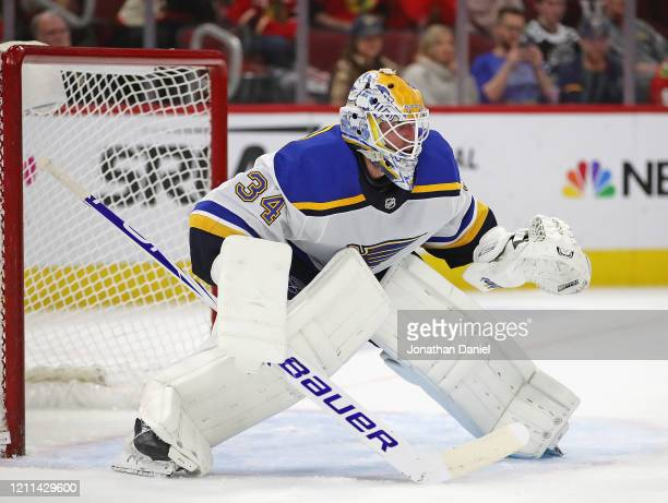 Jake Allen of the St. Louis Blues minds the net against the Chicago Blackhawks at the United Center on March 08, 2020 in Chicago, Illinois. The Blues...