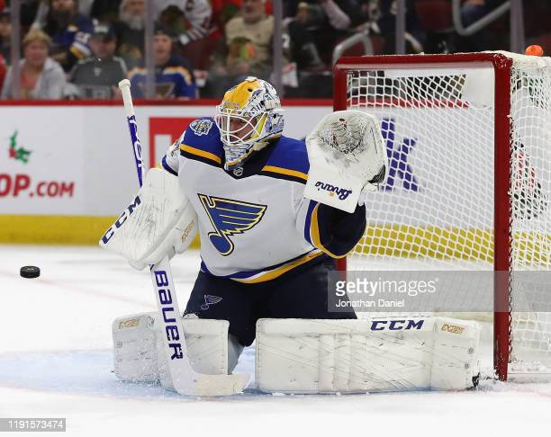 Jake Allen of the St Louis Blues readies to make a save against the Chicago Blackhawks at the United Center on December 02 2019 in Chicago Illinois