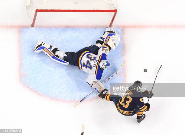 Jake Allen of the St Louis Blues stops Conor Sheary of the Buffalo Sabres on a second period scoring chance during an NHL game on March 17 2019 at...