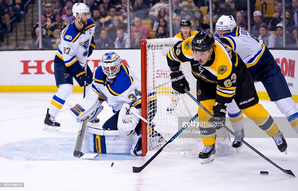 Jake Allen #34 of the St. Louis Blues tends goal as Brad Marchand #63 of the Boston Bruins skates behind the net during the third period at TD Garden on November 22, 2016 in Boston, Massachusetts. The Blues won 4-2.
