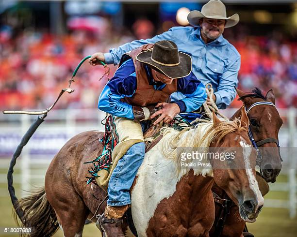 SHOWGROUND SYDNEY NSW AUSTRALIA Jake Andrews gets assistance following his bareback ride during the Sydney Royal Rodeo Series State of Origin Round 3...