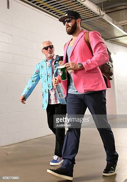 Jake Arrieta and Joe Maddon of the Chicago Cubs exit the stadium while taking part in the Cubs Zany Suit roadtrip after playing the Pittsburgh...