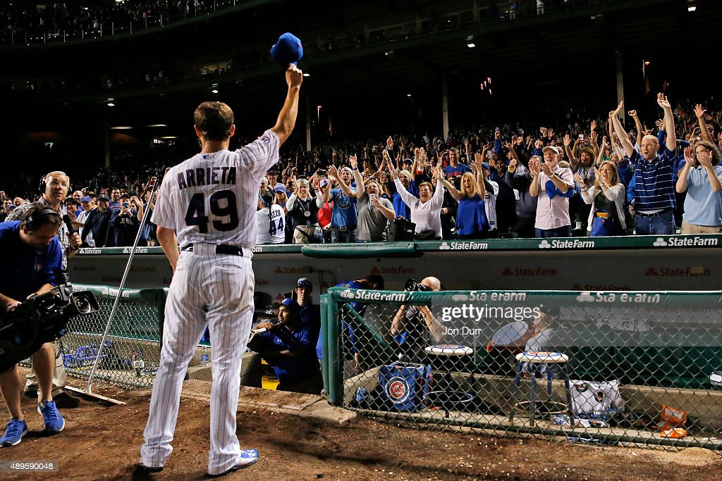 Jake Arrieta #49 celebrates his 20th win of the season against the Milwaukee Brewers at Wrigley Field on September 22, 2015 in Chicago, Illinois. The Chicago Cubs won 4-0.