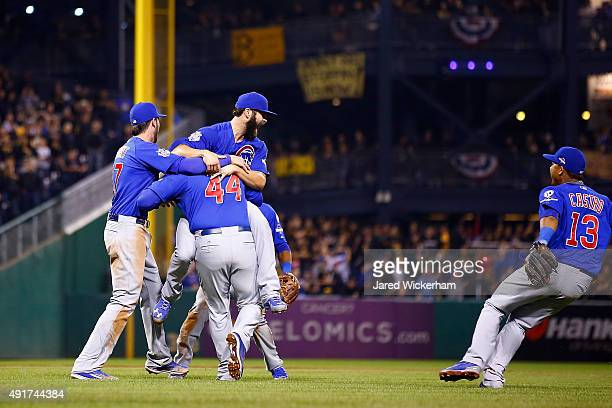 Jake Arrieta of the Chicago Cubs celebrates with Anthony Rizzo of the Chicago Cubs Kris Bryant of the Chicago Cubs and Starlin Castro of the Chicago...
