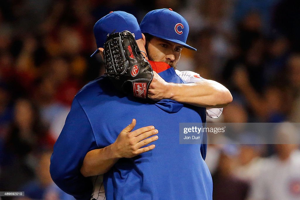 Jake Arrieta #49 of the Chicago Cubs hugs David Ross #3 after his 20th win of the season against the Milwaukee Brewers at Wrigley Field on September 22, 2015 in Chicago, Illinois. The Chicago Cubs won 4-0.